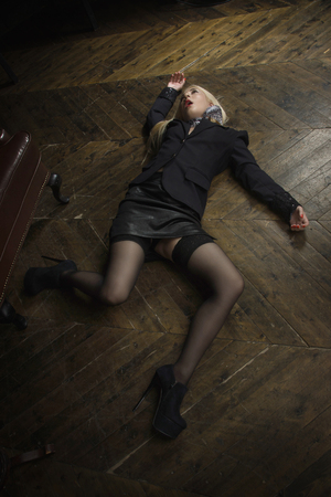Crime scene (imitation). Strangled business woman in the classical library room  Stock Photo