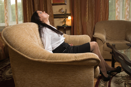 Strangled beautiful business woman in his room. Simulation of the crime scene.