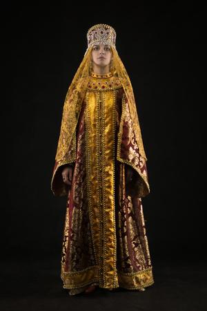 Portrait of Russian queen in historical dress suit  Stock Photo