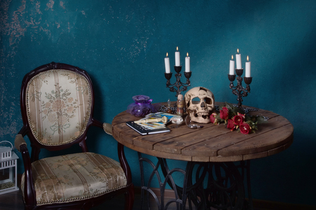 Helloween. Mystic still life with skull, tarot cards, books and candles