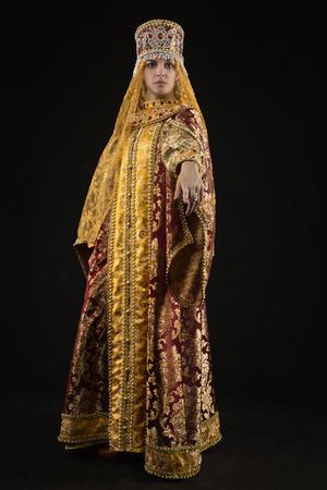 Portrait of Russian queen in historical dress suit