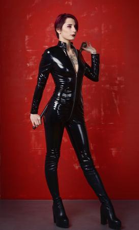 Beautiful fetish model in latex costume. BDSM concept