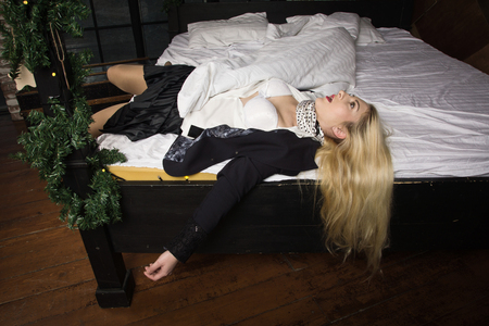 Crime scene (imitation). Strangled business woman lying on the bed