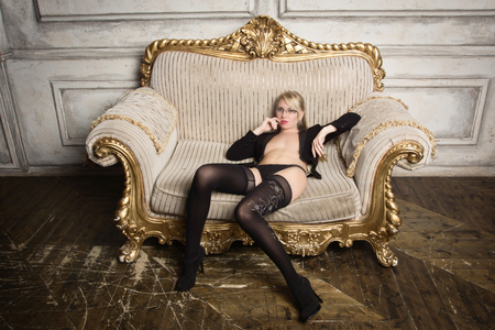 Sexy half-naked woman in glasses and business suit. Erotic concept Standard-Bild