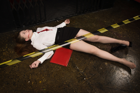 Crime scene. Business woman shot in the chest in old elevator 스톡 콘텐츠