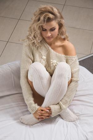 Beautiful  blonde woman in living room interior