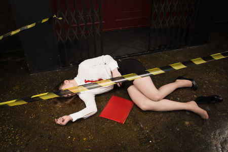 Crime scene. Business woman shot in the chest in old elevator Standard-Bild - 97420111
