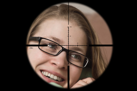 Sniper aims at his victim through the sight of a sniper rifle Stock Photo - 99121575