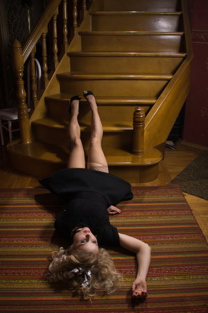 Accident. Dead beautiful woman on the stairs