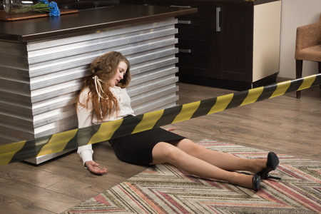 Crime scene with strangled  business woman (imitation)