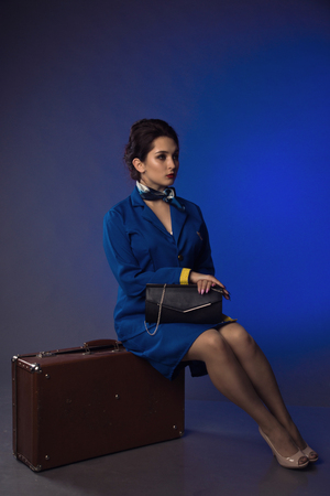 beautiful young pinup girl in suit of stewardess