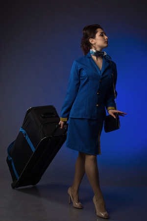 beautiful young pinup girl in suit of stewardess Stock Photo