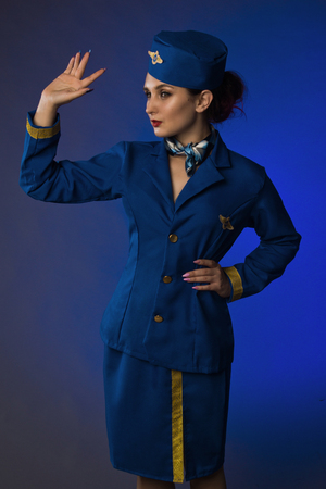 beautiful young pinup girl in suit of stewardess Stockfoto