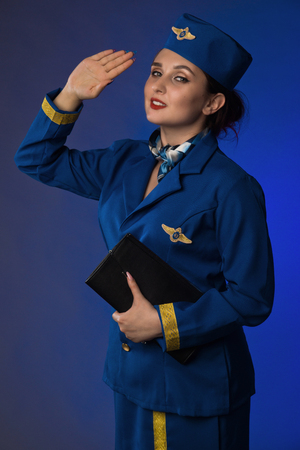 beautiful young pinup girl in suit of stewardess 版權商用圖片