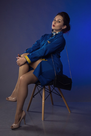 beautiful young pinup girl in suit of stewardess Foto de archivo
