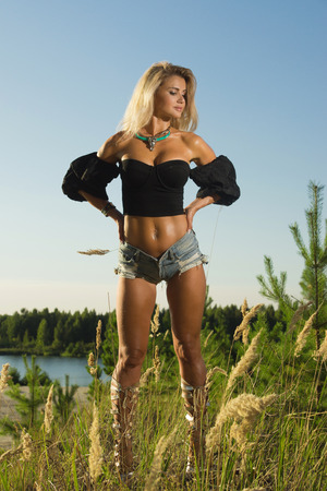 Country fashionable girl in the summer forest Archivio Fotografico