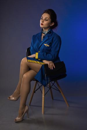 beautiful young pinup girl in suit of stewardess Imagens