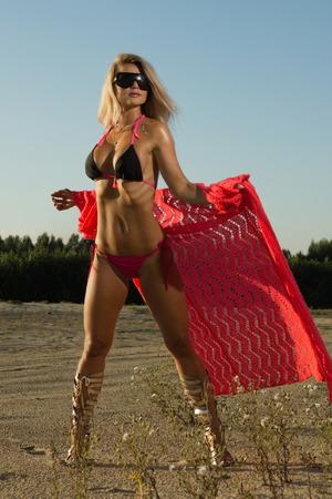 Sexual woman posing in a sandy desert