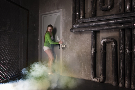 Thriller film. Girl suffocating from poisonous smoke
