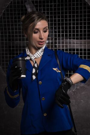 Young beautiful flight attendant in uniform. Not contain any logos or trademark.