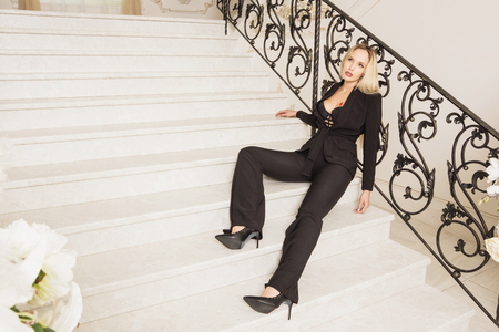 Crime scene. Business woman shot to death on the luxury stairs Stock Photo