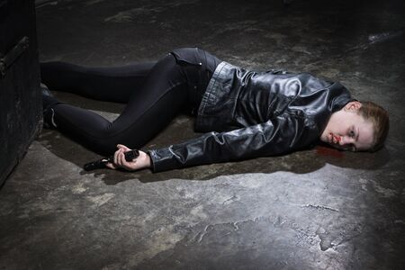 Crime scene imitation. Dead woman lying on a floor Standard-Bild