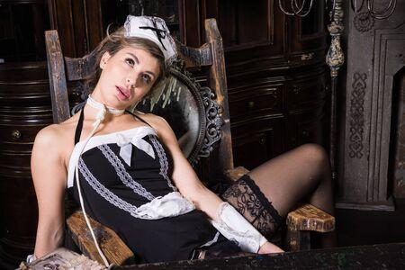 Crime scene imitation. Strangled chambermaid on the table
