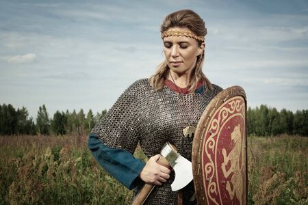 Viking girl warrior with axe in hand fighted 스톡 콘텐츠
