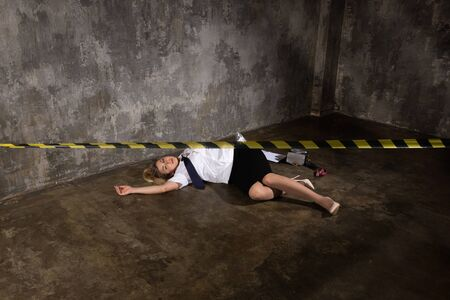 Crime scene imitation. Dead woman police officer lying on a floor