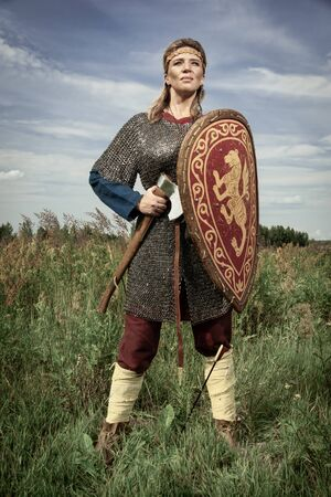 Viking girl warrior with axe in hand fighted