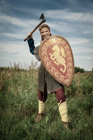 Viking girl warrior with axe in hand fighted 写真素材