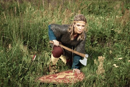 Viking girl warrior with axe in hand fighted 版權商用圖片