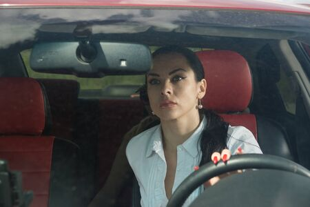 Scene from a detective series. Assault on a woman in her car.