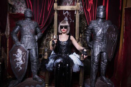 Pretty gothic girl in a dark room interior