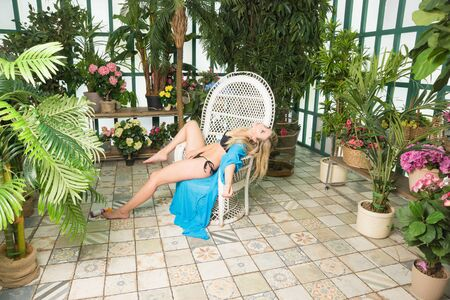 Body of a dead woman in the greenhouse