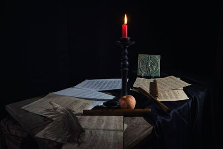 Musical still life in the Renaissance style with pipes and scores
