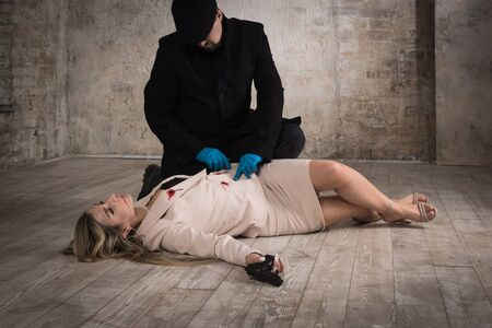 Film noir. Detective investigating the crime scene
