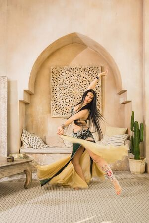 Beautiful belly dancer in motion
