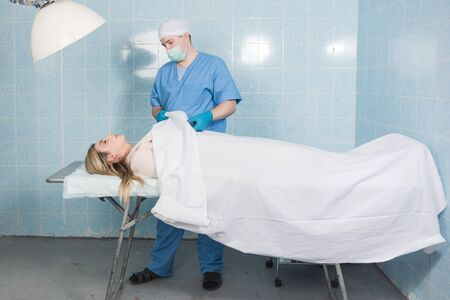Coroner inspects the body of the crime victim (imitation)