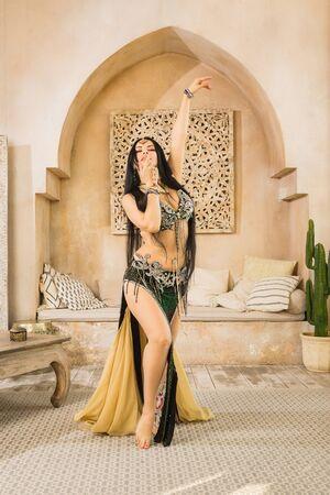 Beautiful belly dancer in motion Standard-Bild