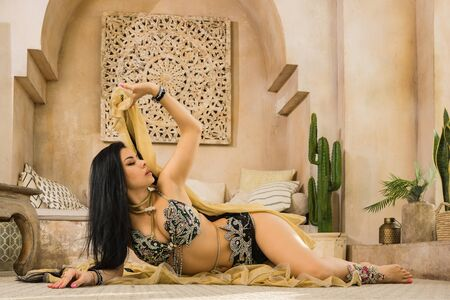 Beautiful traditional female dancer. Oriental dancer woman. Belly dancing.