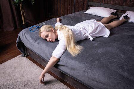 Crime scene imitation. Strangled nurse in the bedroom