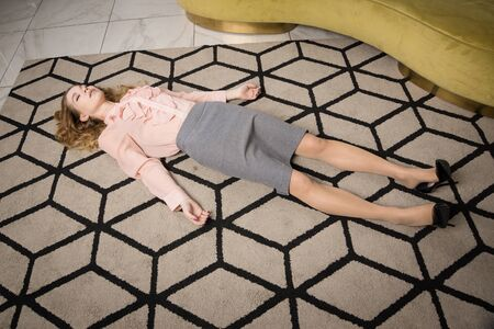 Crime scene with strangled pretty business woman in office