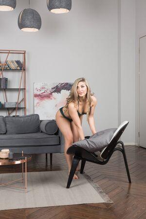 Sexual emotional attractive woman  in erotic lace underwear posing in a boudoir Archivio Fotografico