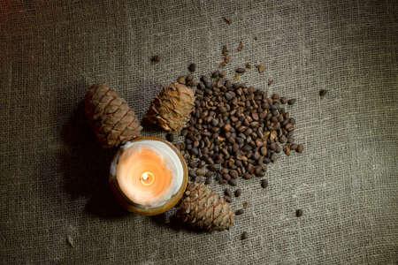 Still life of pine nuts on burlap Foto de archivo