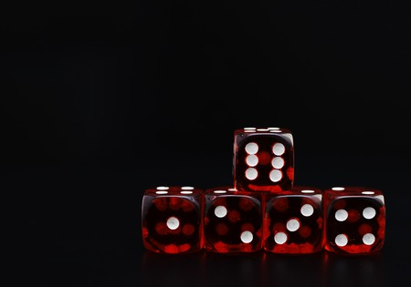 detail of five red dice on black background