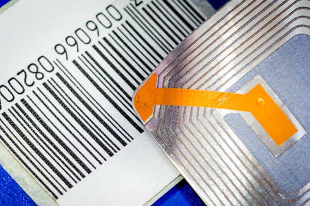 Close up of RFID tags ana a code bar used for tracking and identification purposes and as an anti-theft system in commerce and retail. Stock Photo