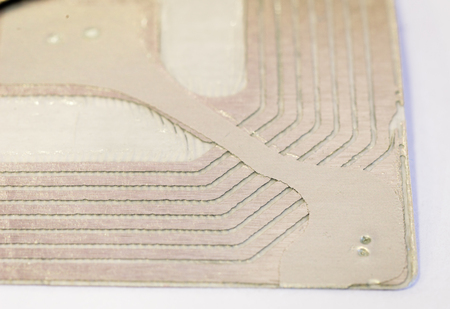 Macro detail of a RFID tags used for tracking and identification purposes and as an anti-theft system in commerce and retail.