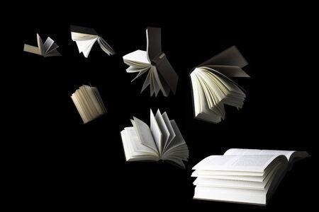 Flying books isolated on black Stock Photo
