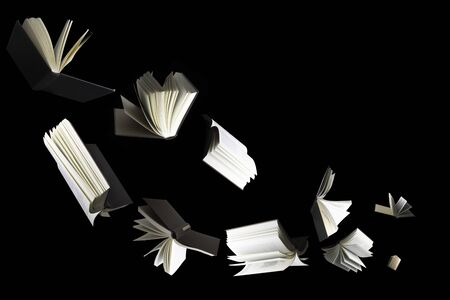 Flying several books isolated on black background.